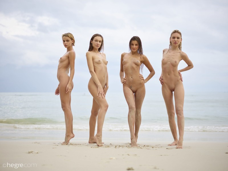 Models posing together in beach nudes