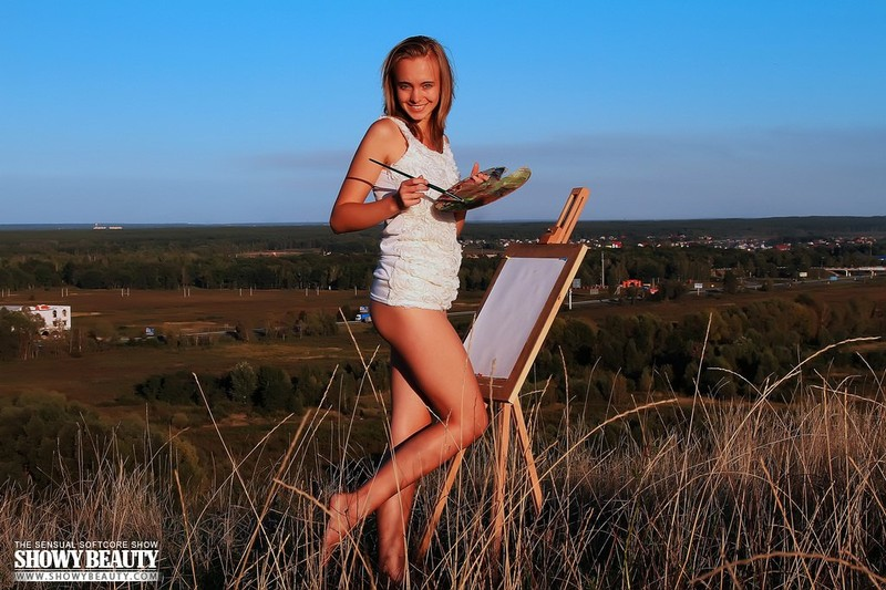 Hot Dana poses outdoors while painting showing